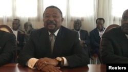 FILE - Gabon opposition leader Jean Ping attends a meeting with advisers in Libreville, Gabon, Sept. 26, 2016.