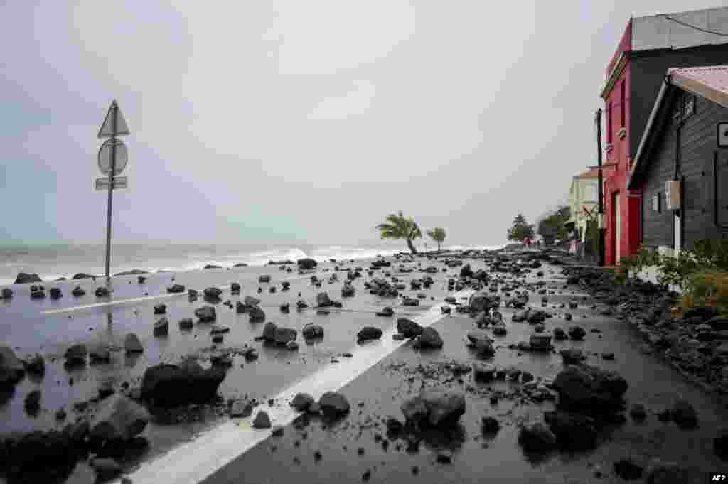 A picture shows rocks swept by strong waves onto a road in Le Carbet, on the French Caribbean island of Martinique, after it was hit by Hurricane Maria.