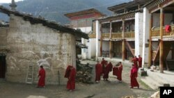 FILE - Tibetan nuns walk through the grounds of the Taibaling Nunnery at Shusong Village, in the mountains about 50 kilometers (31 miles) from the border with Tibet, in China's southwest Yunnan province Tuesday March 25, 2008. The nunnery was rebuilt on the site of a 300-year-old monastery after the monastery and the nearby nunnery were destroyed during China's 1966-76 Cultural Revolution. Some 130 Tibetan nuns currently study at the nunnery.