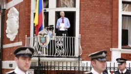 WikiLeaks founder Julian Assange steps onto the balcony before speaking to the media outside the Ecuador embassy in west London, August 19, 2012.