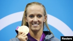 Dana Vollmer of the U.S. holds her gold medal during the women's 100m butterfly victory ceremony during the London 2012 Olympic Games at the Aquatics Centre July 29, 2012.