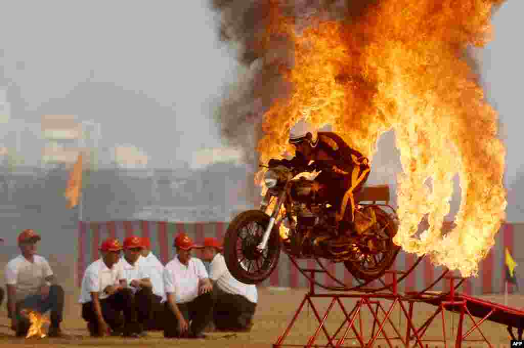 An member of the Indian army's 'Tornadoes' motorcycle display team rides during a combined display at an officer training academy in Chennai on March 9, 2018.