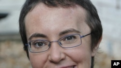 US Congresswoman Gabrielle Giffords smiles in one of the images released June 12, 2011, on her Facebook page