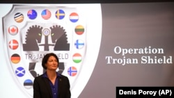 Suzanne Turner, Special Agent in Charge of the FBI, discusses Operation Trojan Shield on June 8, 2021, in San Diego, California. The operation led to the arrests of more than 800 suspects. (AP Photo/Denis Poroy)