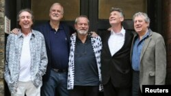 FILE - Members of British comedy troupe Monty Python, from left, Eric Idle, John Cleese, Terry Gilliam, Michael Palin and Terry Jones pose for a photograph during a media event in central London, June 30, 2014.