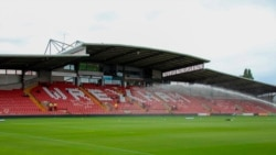 This photo provided by Wrexham FC shows the empty stands of the Racecourse Ground in Wrexham, Wales, Saturday, Sept. 11, 2021.
