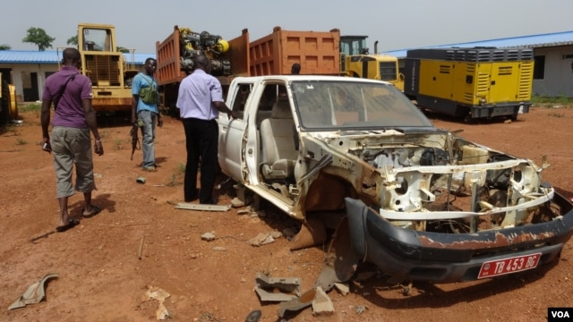 Vehicles that have been stripped for parts during looting at the China International Fund depot in Bangui, March 4, 2014. (Nick Long/VOA)