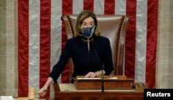 U.S. Speaker of the House Nancy Pelosi wields the gavel as House votes to impeach President Trump