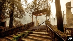 FILE - In this Sept. 28, 2020, file photo, a staircase remains at the Restaurant at Meadowood, which burned in the Glass Fire, in St. Helena, Calif. (AP Photo/Noah Berger, File