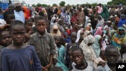 Civilians who fled their homes following an attack by Islamist militants take refuge at a school in Maiduguri, Nigeria, Tuesday, Sept. 9, 2014.