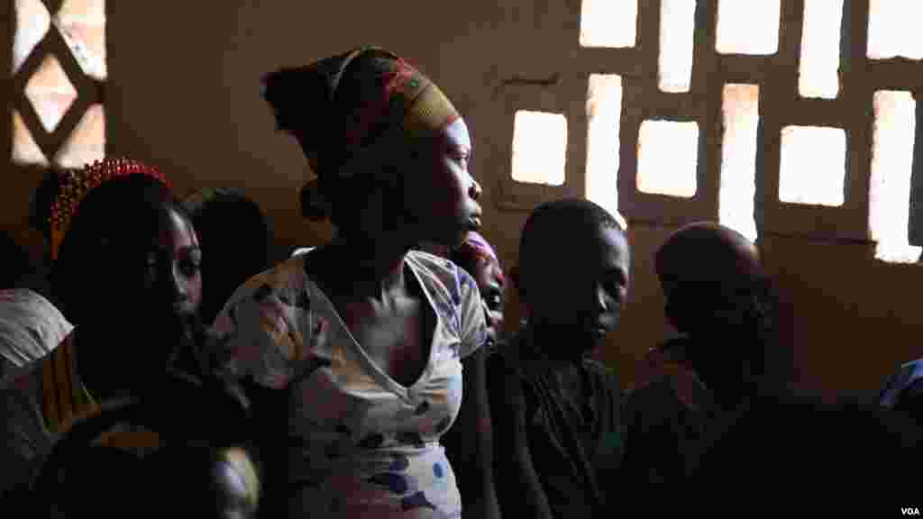 A girl stares out the window at Bossangoa chuch's Sunday prayers. Over 36,000 people are living at the site. (Hanna McNeish for VOA)
