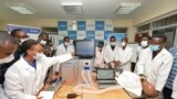 In this photo taken Monday, April 13, 2020, medical students test a self-designed computer-controlled ventilator prototype at the Chandaria Business and Incubation Centre of Kenyatta University in Nairobi, Kenya. (AP PHOTO/John Muchucha)