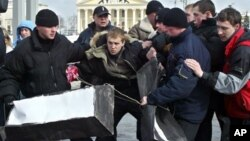 Belarusian plain clothes policemen detain Zmitser Dashkevich, center, opposition youth movement leader, during a protest action in downtown Minsk, Belarus, in this file photo from March 15, 2005.