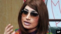 FILE - Pakistani fashion model Qandeel Baloch speaks during a press conference in Lahore, Pakistan, June 28, 2016.
