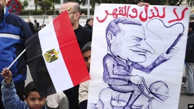 Egyptian children hold an anti-Mubarak cartoon during a protest in Alexandria, Egypt, 4 Feb 2011