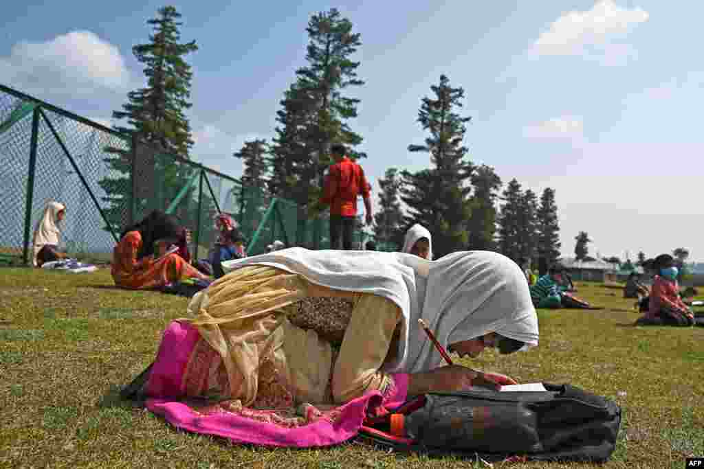 Students attend a class at their open-air school situated on top of a mountain in Doodhpathri, Indian-administered Kashmir, July 27, 2020.Schooling in restive Kashmir has been severely disrupted by the pandemic.