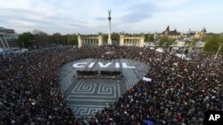 FILE - People gather to protest against then-planned NGO and Central European University laws, in Heroes Square in Budapest, Hungary, April 12, 2017. The European Union has launched legal action against Hungary because of new rules seen discriminating against civic groups that receive funds from abroad.