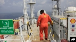 A Shell employee is seen aboard an oil vessel off the coast of Nigeria.