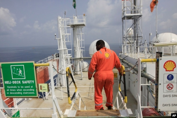 FILE - A Shell employee is seen aboard an oil vessel off the coast of Nigeria in this December 26, 2011, file photo.