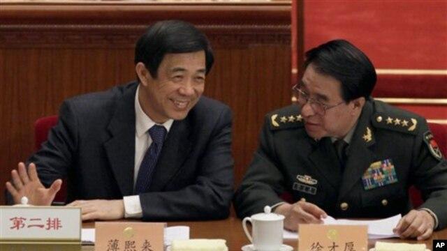 薄熙来和徐才厚将军2010年在全国政协会议上