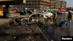Mesto napada automobilom prepunim eksploziva u Bagdadu, 15. januara 2014.