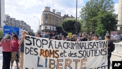 People hold a banner in front of the city hall of Montreuil, east of Paris. France announced a crackdown on the minorities two weeks ago, Interior Minister Brice Hortefeux said, (File August 14, 2010).