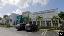 The Miami branch Stonegate Bank is shown, July 22, 2015, in Miami. Stonegate announced it is setting up a correspondent banking relationship with a Cuban financial institution.