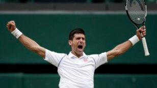 Novak Djokovic of Serbia celebrates winning the men's singles final against Roger Federer of Switzerland at the All England Lawn Tennis Championships in Wimbledon, London, July 12, 2015.