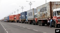 Trucks loaded with containers are lined up outside a terminal at the Jawaharlal Nehru Port Trust in Mumbai, India, June 29, 2017. Operations at a terminal at India's busiest container port have been stalled by the malicious software that suddenly burst across the world's computer screens Tuesday.