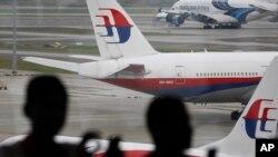 Malaysia Airlines, aéroport international de Kuala Lumpur, Malaisie, le 14 mars 2016. (AP Photo/Joshua Paul)