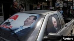 Lazkiye'de Beşar Esat ve Rusya Devlet Başkanı Vladimir Putin' yanlısı gösteriler