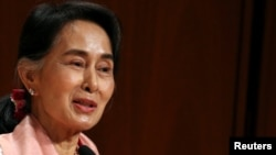 The government says on Sept. 29, 2016, Myanmar leader Aung San Suu Kyi has returned to the country's capital after a brief illness following her visit to the United States.