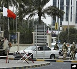 Troops are seen guarding one of the entrances of Salmaniya Hospital in Manama, Bahrain, March 18, 2011