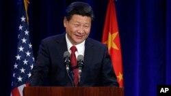 Presiden China Xi Jinping berbicara dalam sebuah acara di Seattle, Washington dalam lawatannya ke AS (22/9).