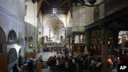 Des touristes visitant l'Eglise de la Nativité à Bethlehem (Archives)