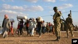 Cuộc xung đột ở Trung Đông và Bắc Phi đã khơi ra dòng người tị nạn đổ sang các nước láng giềng. (Ảnh tư liệu)