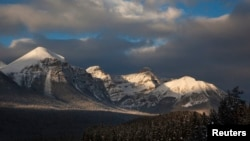 FILE - A mountain range inside Banff national Park is seen in the early morning in Lake Louise, Alberta, Dec. 2, 2010. The national park, Canada's oldest, is in the Rocky Mountains. Howse Peak is about 55 kilometers northwest of Lake Louise.