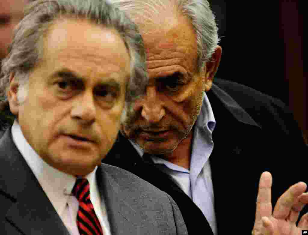 May 16: Dominique Strauss-Kahn, head of the International Monetary Fund, right, with his attorney Benjamin Brafman, is arraigned at Manhattan Criminal Court in New York, on charges he sexually assaulted a hotel maid on Saturday. (AP Photo)