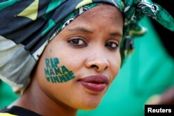 An African National Congress (ANC) supporter arrives at a memorial service for Winnie Madikizela-Mandela at Orlando Stadium in Johannesburg's Soweto township, South Africa, April 11, 2018.