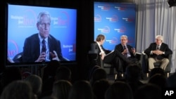 Former Washington Post reporter Bob Woodward, is seen on the monitor as moderator Charlie Rose, left, Woodward and Bernstein speak during an event to commemorate the 40th anniversary of Watergate, June 11, 2012.