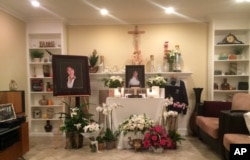 A memorial is displayed in the family home of Tin Nguyen in Anaheim, Calif., Dec. 5, 2015.