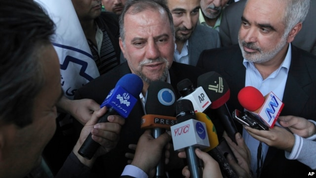 Iranian scientist Mojtaba Atarodi (C), who was in U.S. custody since late 2011, speaks to journalists, upon his arrival at the Imam Khomeini airport outside Tehran, April 27, 2013.