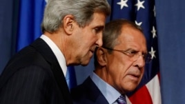 U.S. Secretary of State John Kerry (L) and Russian Foreign Minister Sergei Lavrov are seen talking after a joint news conference in Geneva, September 14, 2013.