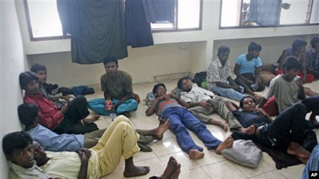 Ethnic Rohingya boat people rest after being rescued at sea, at a port in Aceh Besar, Aceh province, Indonesia, February 16, 2011 (file photo)