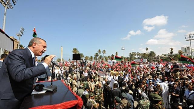 Turkish Prime Minister Recep Tayyip Erdogan addresses Libyans at Tripoli Airport, September 16, 2011.