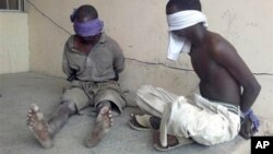 Suspected Boko Haram militants detained by military in Bukavu Barracks, Kano state, Nigeria, March 2012 file photo.