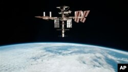 International Space Station photographed by Expedition 27 crew member Paolo Nespoli from the Soyuz TMA-20 after undocking, image released May 9, 2013.
