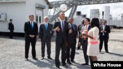 President Barack Obama tosses a Soccket ball in the air at the Ubongo Power Plant in Dar es Salaam, Tanzania, July 2, 2013.