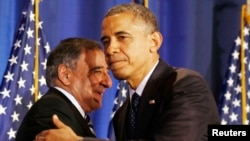 FILE - President Barack Obama (R) and then U.S. Secretary of Defense Leon Panetta are seen together at the National Defense University in Washington, December 2012.