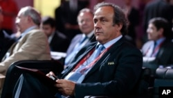 FILE - UEFA President Michel Platini waits for the beginning of the preliminary draw for the 2018 soccer World Cup in Konstantin Palace in St. Petersburg, Russia, July 25, 2015.